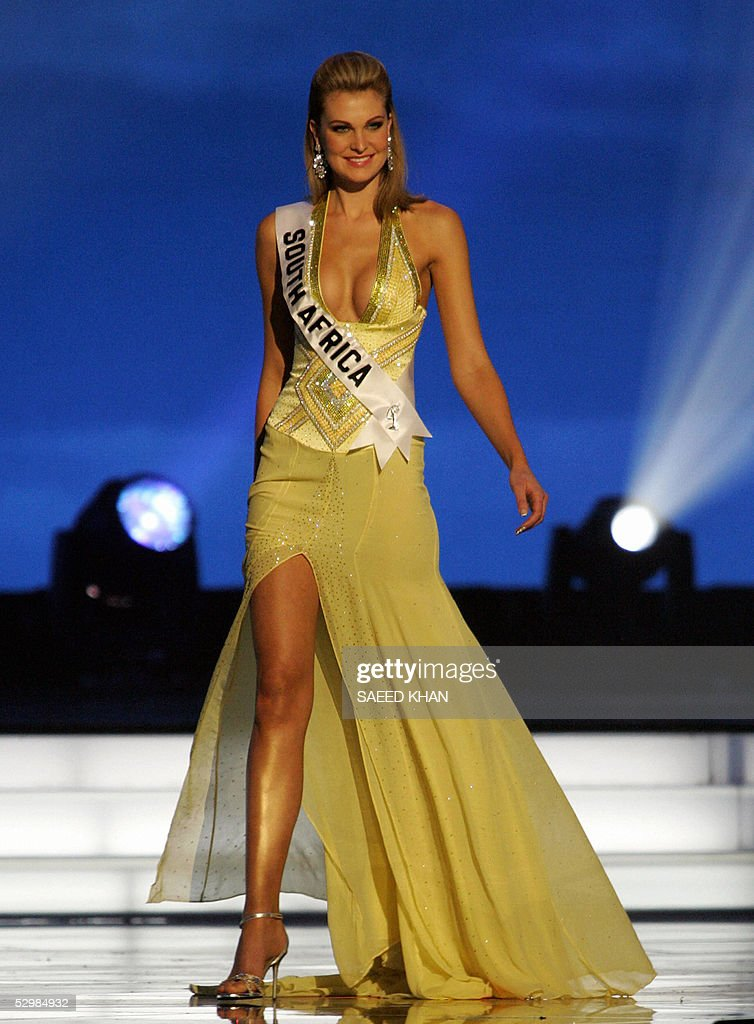 Miss Universe 2005 contestant Miss South Africa Claudia Henkel performs during the first round of judging in the swimwear and evening gown competition in Bangkok, 26 May 2005. The reigning Miss Universe, Jennifer Hawkins from Australia, will crown her successor in Bangkok before thousands of journalists and spectators on May 31. AFP PHOTO/ SAEED KHAN