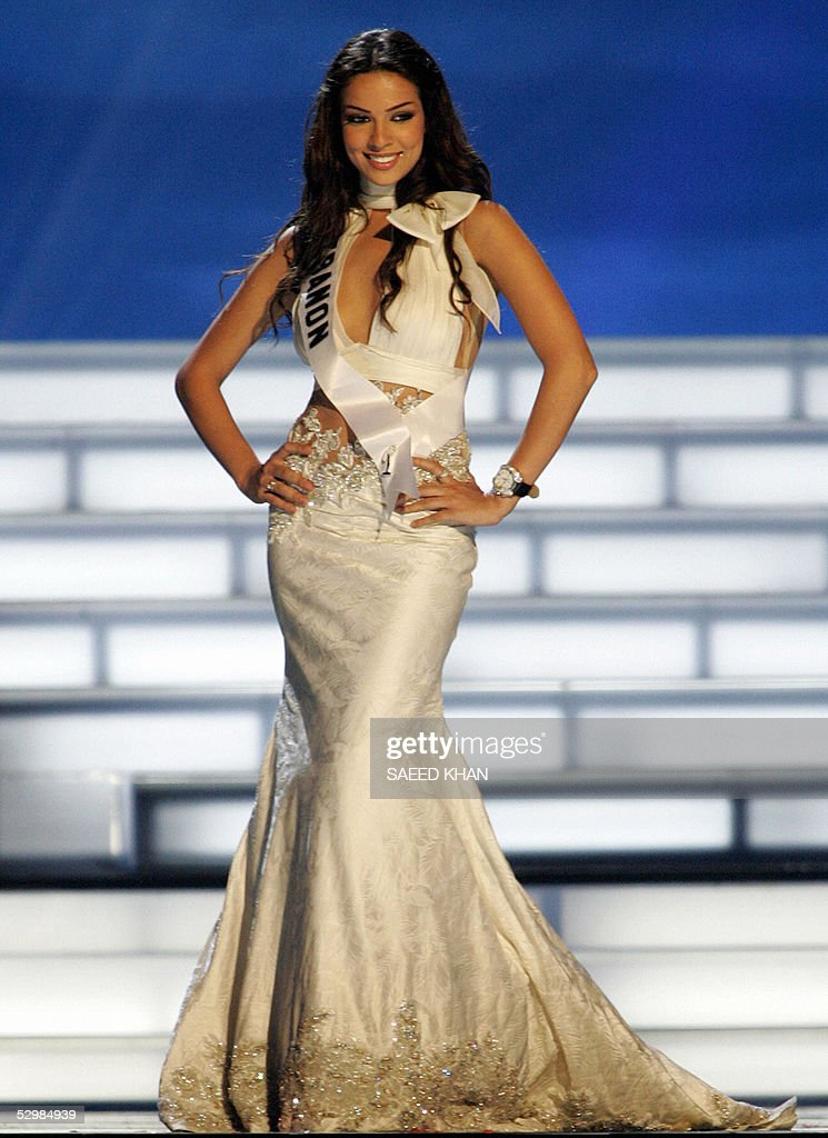 Miss Universe 2005 contestant Nadine Njeim of Lebanon presents evening gown during the first round of judging in the swimwear and evening gown competition in Bangkok, 26 May 2005. The reigning Miss Universe, Jennifer Hawkins from Australia, will crown her successor in Bangkok before thousands of journalists and spectators on May 31. AFP PHOTO/ SAEED KHAN