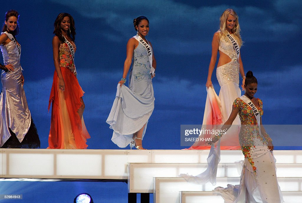 Miss Universe 2005 contestants (From R), Miss Aruba Luisana Cicilia, Miss Australia Michelle Guy, Miss Bahamas Denia Nixon, Miss Barbadoa Nada Yearwood and Miss Belgium Debby De Waele present evening gowns during the first round of judging in the swimwear and evening gown competition in Bangkok, 26 May 2005. The reigning Miss Universe, Jennifer Hawkins from Australia, will crown her successor in Bangkok before thousands of journalists and spectators on May 31. AFP PHOTO/ SAEED KHAN
