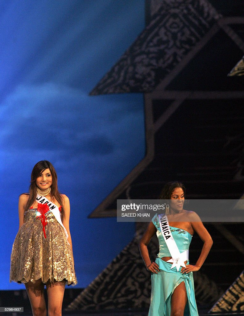 Miss Universe 2005 contestants Miss Japan Yukari Kuzuya (L) and Miss Jamaica Raquel Wright present evening gowns during the first round of judging in the swimwear and evening gown competition in Bangkok, 26 May 2005. The reigning Miss Universe, Jennifer Hawkins from Australia, will crown her successor in Bangkok before thousands of journalists and spectators on May 31. AFP PHOTO/ SAEED KHAN