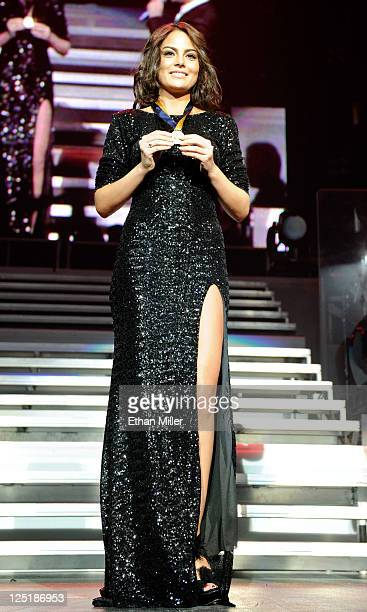 Miss Universe 2010 Jimena Navarrete holds a medallion singer Alejandro Fernandez gave her while performing during his Dos Mundos tour at the MGM...