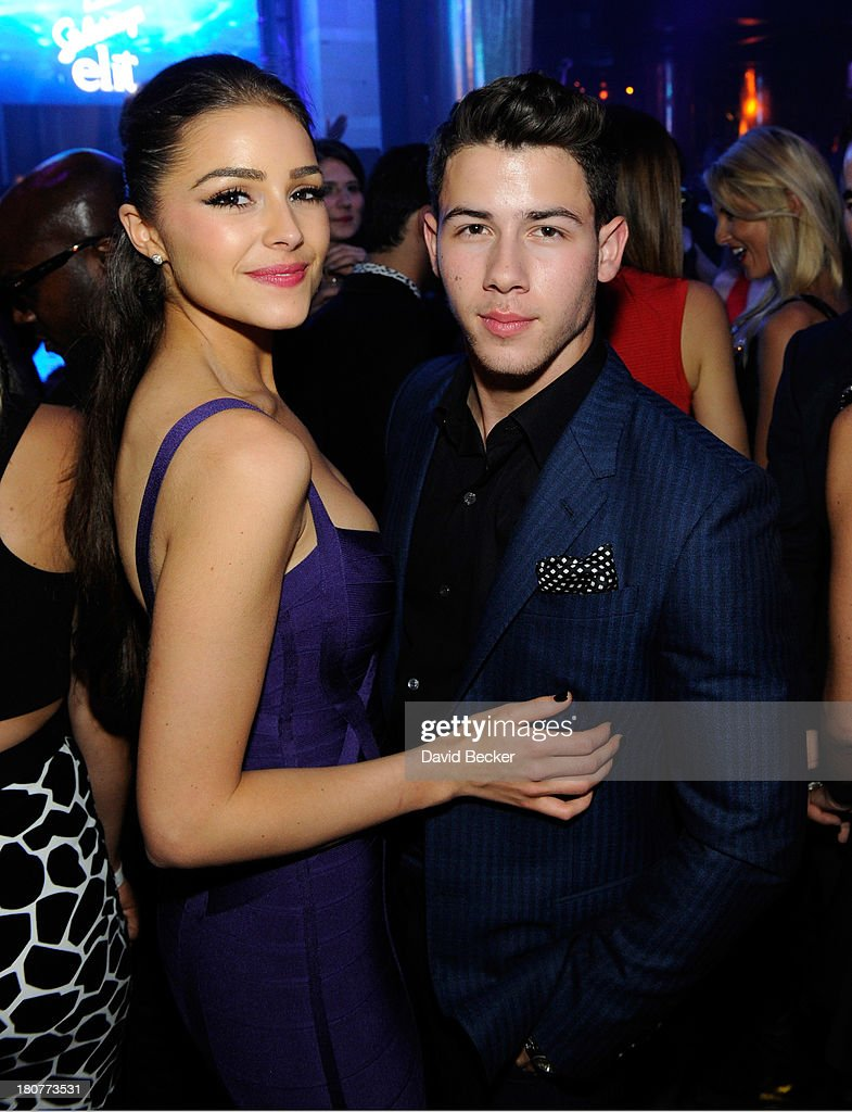 Miss Universe 2012 Olivia Culpo (L) and Nick Jonas celebrates his 21st birthday at XS The Nightclub at Encore Las Vegas on September 16, 2013 in Las Vegas, Nevada.