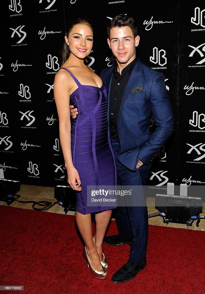 Miss Universe 2012 Olivia Culpo (L) and recording artist Nick Jonas arrive at XS The Nightclub at Encore Las Vegas to celebrates his 21st birthday on September 16, 2013 in Las Vegas, Nevada.