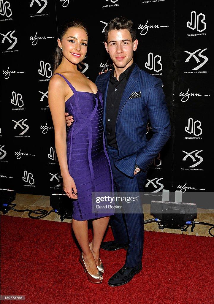 Miss Universe 2012 Olivia Culpo (L) and recording artist Nick Jonas arrive at XS The Nightclub at Encore Las Vegas to celebrates his 21st birthday on September 16, 2013 in Las Vegas, Nevada.