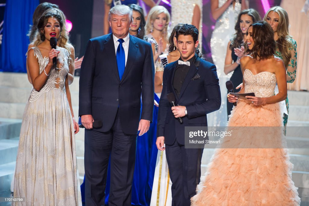 Miss Universe 2012 <a gi-track='captionPersonalityLinkClicked' href=/galleries/search?phrase=Olivia+Culpo&family=editorial&specificpeople=9194131 ng-click='$event.stopPropagation()'>Olivia Culpo</a>, <a gi-track='captionPersonalityLinkClicked' href=/galleries/search?phrase=Donald+Trump+-+Born+1946&family=editorial&specificpeople=118600 ng-click='$event.stopPropagation()'>Donald Trump</a>, musician and host <a gi-track='captionPersonalityLinkClicked' href=/galleries/search?phrase=Nick+Jonas&family=editorial&specificpeople=842713 ng-click='$event.stopPropagation()'>Nick Jonas</a>, Television personality and host <a gi-track='captionPersonalityLinkClicked' href=/galleries/search?phrase=Giuliana+Rancic&family=editorial&specificpeople=556124 ng-click='$event.stopPropagation()'>Giuliana Rancic</a> during the 2013 Miss USA pageant at PH Live at Planet Hollywood Resort & Casino on June 16, 2013 in Las Vegas, Nevada.