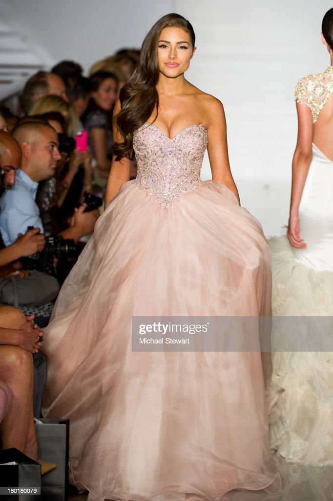 Miss Universe 2012 <a gi-track='captionPersonalityLinkClicked' href=/galleries/search?phrase=Olivia+Culpo&family=editorial&specificpeople=9194131 ng-click='$event.stopPropagation()'>Olivia Culpo</a> walks the runway during the Evening By Sherri Hill Spring 2014 show at Trump Tower on September 9, 2013 in New York City.