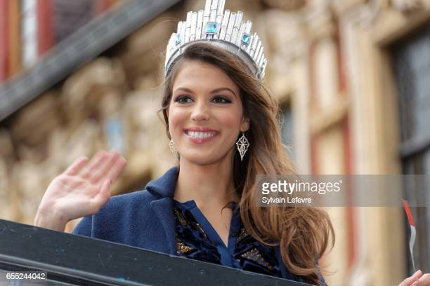 Miss Universe 2017 and Miss France 2016 Universe Mittenaere salutes the crowd on the top upon her arrival to visit Lille her hometown on March 19...