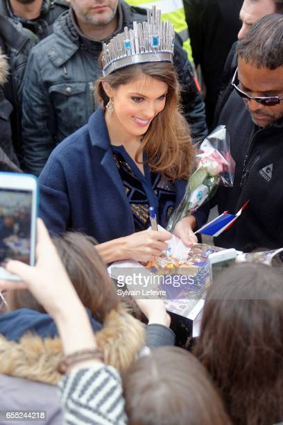 Miss Universe 2017 and Miss France 2016 Universe Mittenaere autographs upon her arrival to visit Lille her hometown on March 19 2017 in Lille France