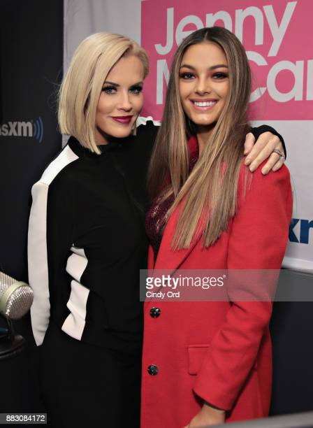 Miss Universe 2017 DemiLeigh NelPeters poses for a photo with SiriusXM host Jenny McCarthy during a visit to The Jenny McCarthy Show at the SiriusXM...