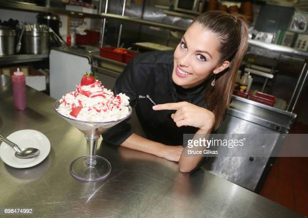 Miss Universe 2017 Iris Mittenaere visit Buca di Beppo Times Square on June 19 2017 in New York City