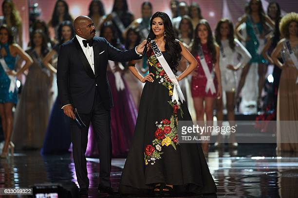 Miss Universe candidate Andrea Tovar of Colombia answers a question from pageant host Steve Harvey of the US during the finals of the Miss Universe...