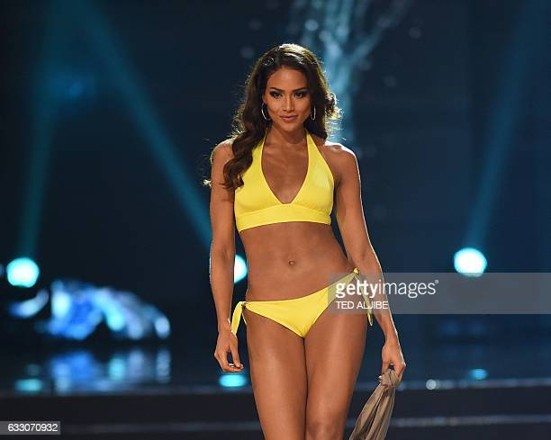 Miss Universe candidate Andrea Tovar of Colombia in her swimsuit walks on stage during the finals of the Miss Universe pageant at the Mall of Asia...