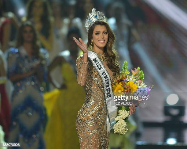 TOPSHOT Miss Universe candidate Iris Mittenaere of France waves to the audience after winning the title in the Miss Universe pageant at the Mall of...
