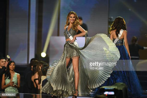 Miss Universe candidate Mariam Hambach of Venezuela in her long gown walks on stage during the finals of the Miss Universe pageant at the Mall of...