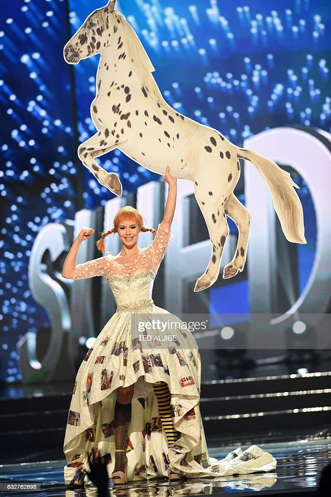 Miss Universe contestant Ida Ovmar of Sweden presents during the national costume and preliminary competition of the Miss Universe pageant at the Mall of Asia arena in Manila on January 26, 2017. / AFP / TED
