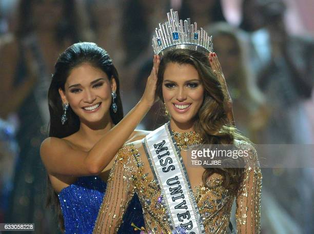 Miss Universe contestant Iris Mittenaere of France is crowned the new 2017 winner by former Miss Universe Pia Wurtzbach of the Philippines during the...
