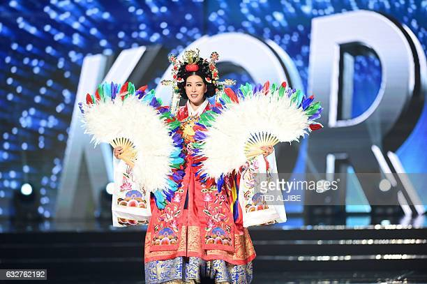 Miss Universe contestant Jenny Kim of South Korea presents during the national costume and preliminary competition of the Miss Universe pageant at...