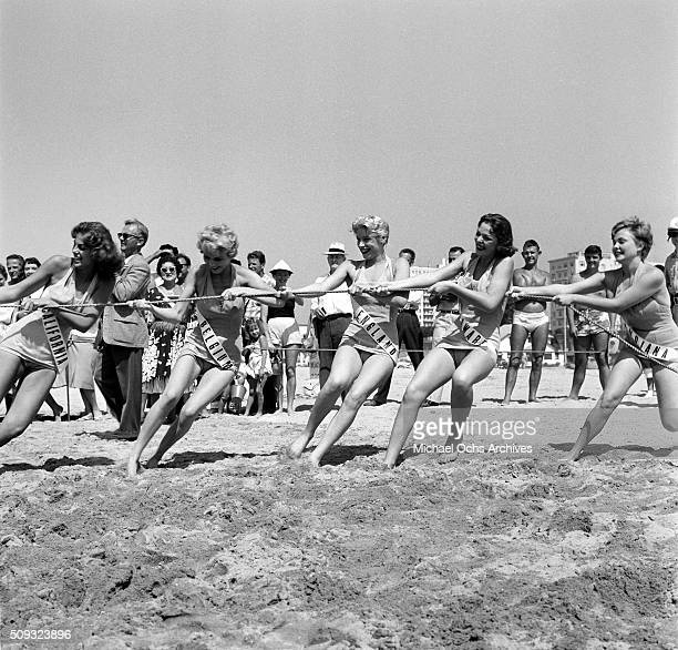 Miss Universe Contestants work together during tug of war competition during a parade in Long Beach California 'n