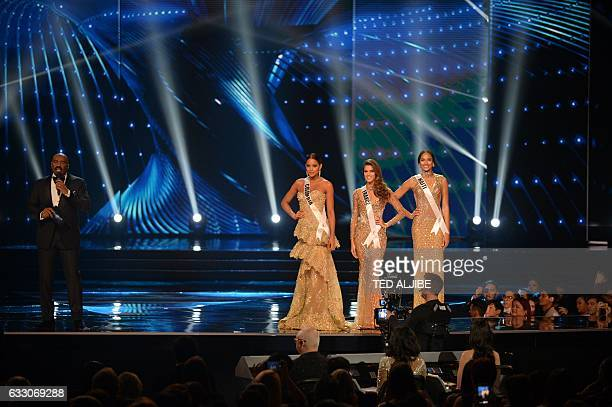 Miss Universe finalists Andrea Tovar of Colombia Iris Mittenaere of France and Raquel Pelissier of Haiti listen as pageant host Steve Harvey of the...