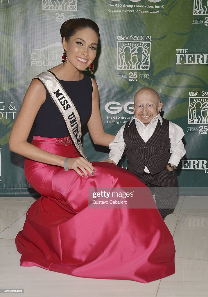 Miss Universe Gabriela Isler and Verne Troyer attend the 18th Annual Best Buddies Miami Gala: Southeast Asia at Fontainebleau Miami Beach on November 21, 2014 in Miami Beach, Florida.