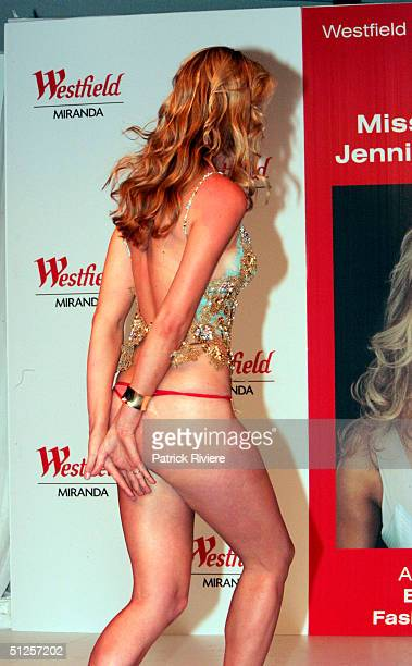Miss Universe Jennifer Hawkins loses her dress during a spring fashion parade at the Miranda Westfield Shopping Centre September 2 2004 in Sydney...