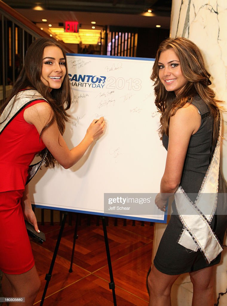 Miss Universe <a gi-track='captionPersonalityLinkClicked' href=/galleries/search?phrase=Olivia+Culpo&family=editorial&specificpeople=9194131 ng-click='$event.stopPropagation()'>Olivia Culpo</a> (L) and Miss USA Erin Brady attend the Annual Charity Day Hosted By Cantor Fitzgerald And BGC at the Cantor Fitzgerald Office on September 11, 2013 in New York, United States.