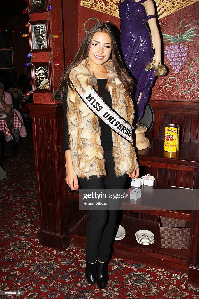 Miss Universe <a gi-track='captionPersonalityLinkClicked' href=/galleries/search?phrase=Olivia+Culpo&family=editorial&specificpeople=9194131 ng-click='$event.stopPropagation()'>Olivia Culpo</a> visits Buca di Beppo Times Square on April 13, 2013 in New York City.