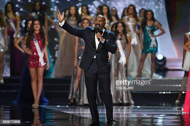 Miss Universe pageant host Steve Harvey of the US speaks next to candidates during the finals of the Miss Universe at the Mall of Asia Arena in...