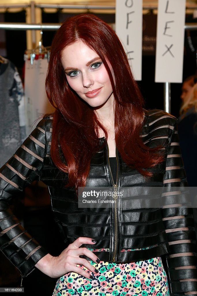 Miss USA 2011 Alyssa Campanella poses backstage at the Lacoste Fall 2013 Mercedes-Benz Fashion Show at The Theater at Lincoln Center on February 9, 2013 in New York City.