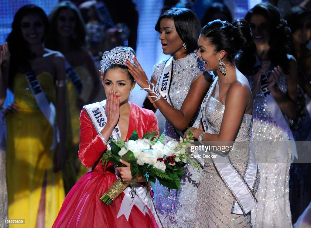 Miss USA 2012, Olivia Culpo, is crowned the 2012 Miss Universe by <a gi-track='captionPersonalityLinkClicked' href=/galleries/search?phrase=Leila+Lopes&family=editorial&specificpeople=8255482 ng-click='$event.stopPropagation()'>Leila Lopes</a>, Miss Universe 2011, as Logan West, Miss Teen USA 2012, looks on during the 2012 Miss Universe Pageant at PH Live at Planet Hollywood Resort & Casino on December 19, 2012 in Las Vegas, Nevada.