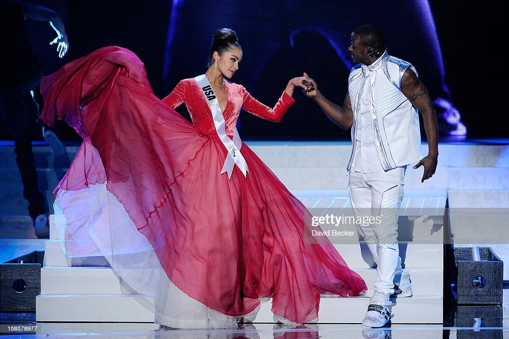 Miss USA 2012, Olivia Culpo (L), is escorted by singer/songwriter and dancer Timomatic during the 2012 Miss Universe Pageant at PH Live at Planet Hollywood Resort & Casino on December 19, 2012 in Las Vegas, Nevada. Culpo went on to be crowned the new Miss Universe.