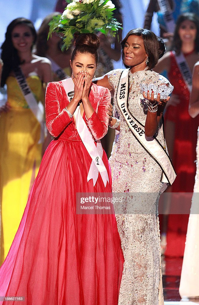 Miss USA 2012 Olivia Culpo [L] reacts as she is crowned the 2012 Miss Universe by Leila Lopes Miss Universe 2011[C] as Logan West Miss Teen USA looks...