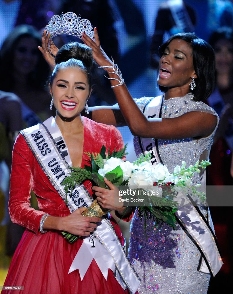 Miss USA 2012, Olivia Culpo (L), reacts as she is crowned the 2012 Miss Universe by <a gi-track='captionPersonalityLinkClicked' href=/galleries/search?phrase=Leila+Lopes&family=editorial&specificpeople=8255482 ng-click='$event.stopPropagation()'>Leila Lopes</a>, Miss Universe 2011, during the 2012 Miss Universe Pageant at PH Live at Planet Hollywood Resort & Casino on December 19, 2012 in Las Vegas, Nevada.
