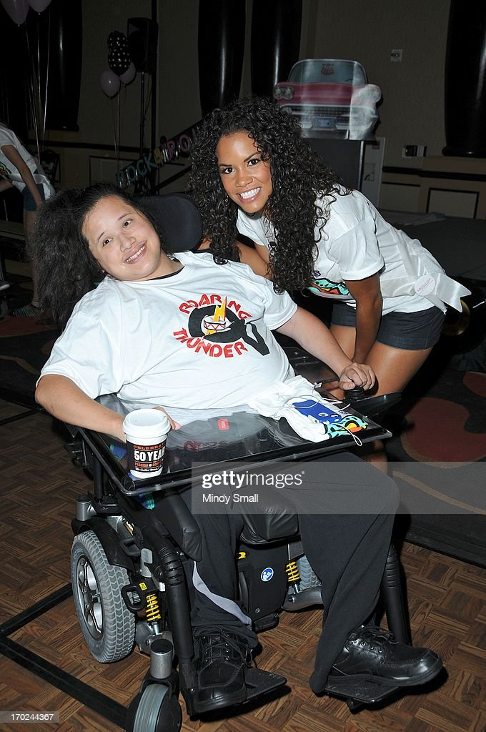 Miss USA 2013 contestant Miss Colorado USA Amanda Wiley (R) meets a member of the Best Buddies organization appear during a sock hop at Planet Hollywood Resort & Casino on June 9, 2013 in Las Vegas, Nevada.
