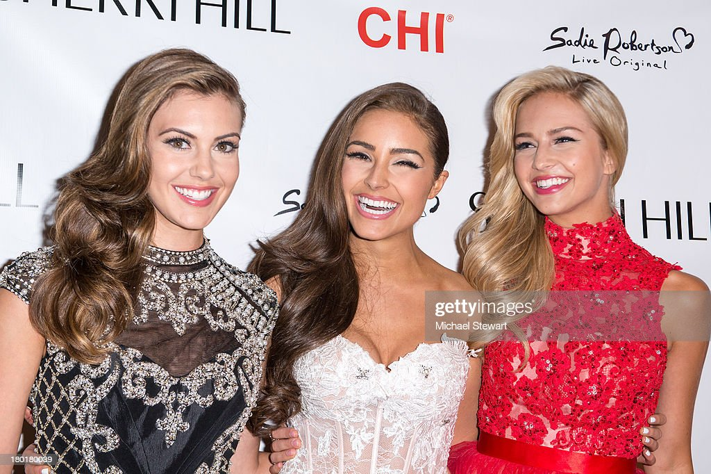 Miss USA 2013 Erin Brady, Miss Universe 2012 Olivia Culpo and Miss Teen USA 2013 Cassidy Wolf attend the Evening By Sherri Hill Spring 2014 show at Trump Tower on September 9, 2013 in New York City.