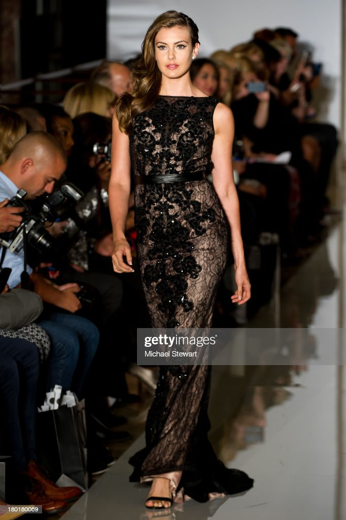 Miss USA 2013 Erin Brady walks the runway during the Evening By Sherri Hill Spring 2014 show at Trump Tower on September 9, 2013 in New York City.