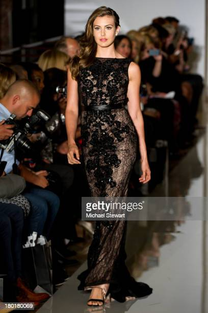 Miss USA 2013 Erin Brady walks the runway during the Evening By Sherri Hill Spring 2014 show at Trump Tower on September 9 2013 in New York City