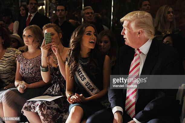 Miss USA 2013 Olivia Culpo and Donald Trump attends the 'Evening' Sherri Hill show during Spring 2013 MercedesBenz Fashion Week at Trump Tower Grand...