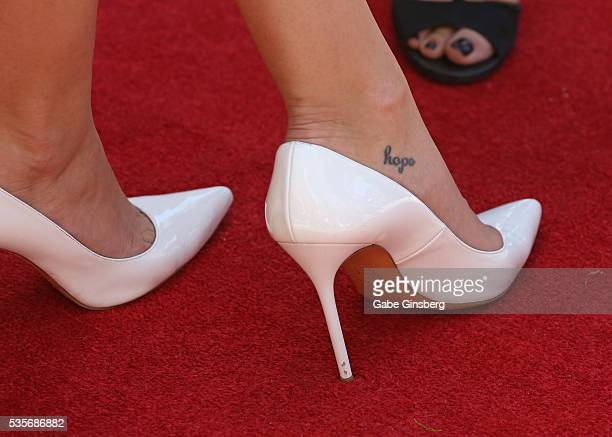 Miss USA 2015 Olivia Jordan shoes tattoo detail attends a launch event for the Las Vegas official Snapchat channel at The Venetian Las Vegas on May...