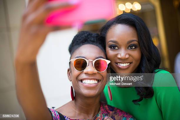 Miss USA 2016 Deshauna Barber poses for a selfie with a fan in Midtown on June 7 2016 in New York City