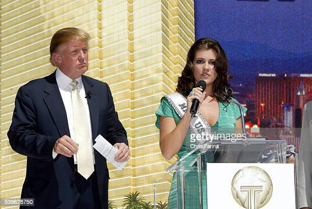 Miss USA Chelsea Cooley speaks while real estate mogul Donald Trump looks on during a groundbreaking ceremony for his Trump International Hotel Tower...