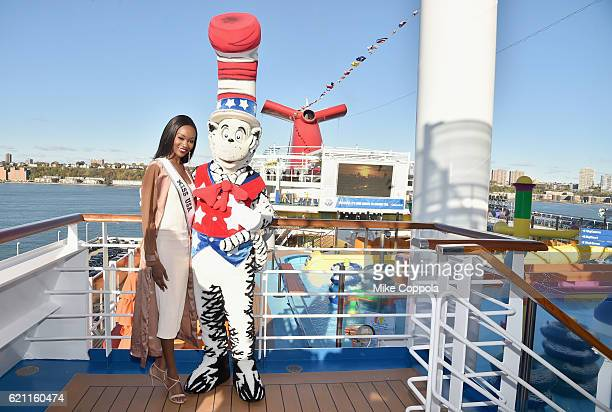 Miss USA Deshauna Barber poses with Dr Seuss at the Carnival Vista US debut with Carrie Underwood and Godmother Miss USA to celebrate the...