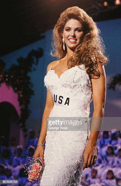 Miss USA Gretchen Polhemus poses in evening wear during the 1989 Cancun Mexico live telecast of the Miss Universe Pageant Polhemus was second...