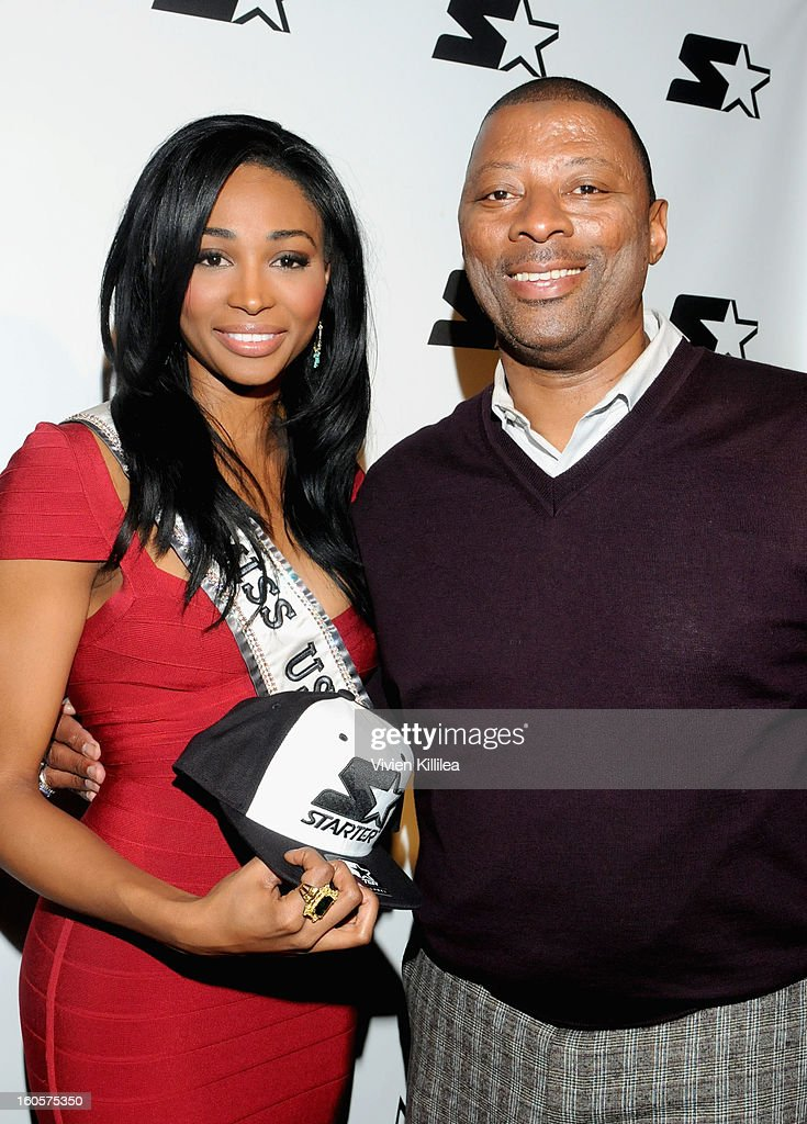 Miss USA Nana Meriwether and NFL player <a gi-track='captionPersonalityLinkClicked' href=/galleries/search?phrase=Carl+Banks&family=editorial&specificpeople=591658 ng-click='$event.stopPropagation()'>Carl Banks</a> pose on the Starter Red Carpet at the Maxim Party during Super Bowl XLVII at Second Line Warehouse on February 2, 2013 in New Orleans, Louisiana.