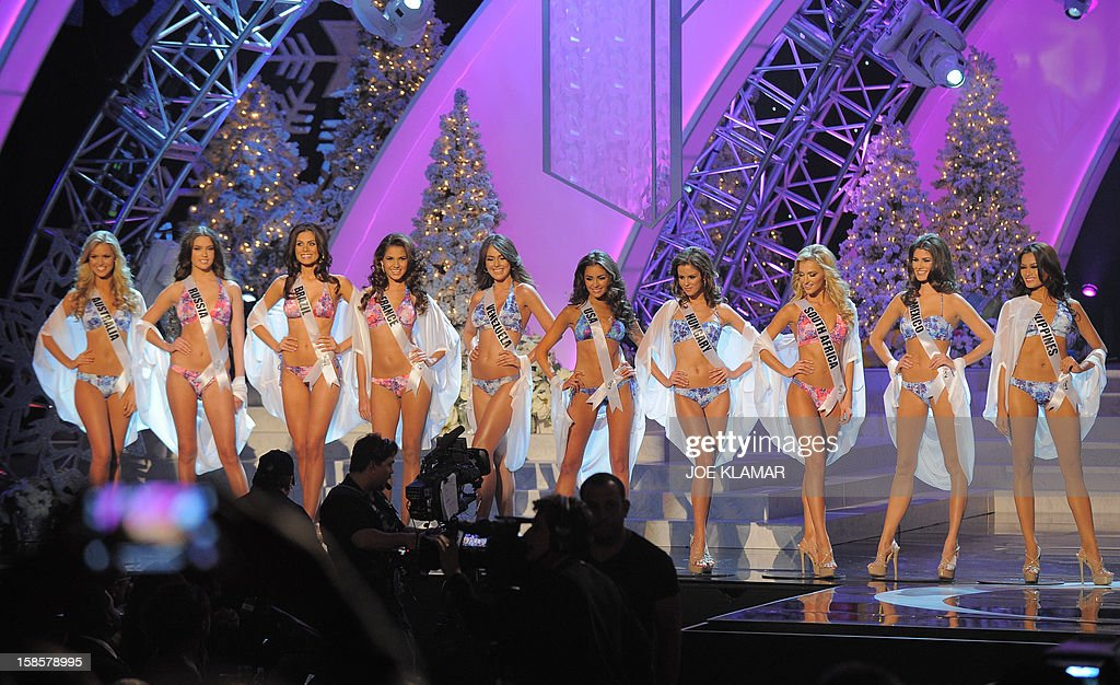 Miss USA, Olivia Culpo (C) and other contestants walk on stage during the Miss Universe Pageant at Planet Hollywood in Las Vegas, Nevada on December 19, 2012. Olivia Culpo was crowned Miss Universe 2012, beating out beauties from around the world to claim the coveted title. The title of first runner-up title went to the contestant from the Philippines, Janine Tugonon. AFP PHOTO / JOE KLAMAR