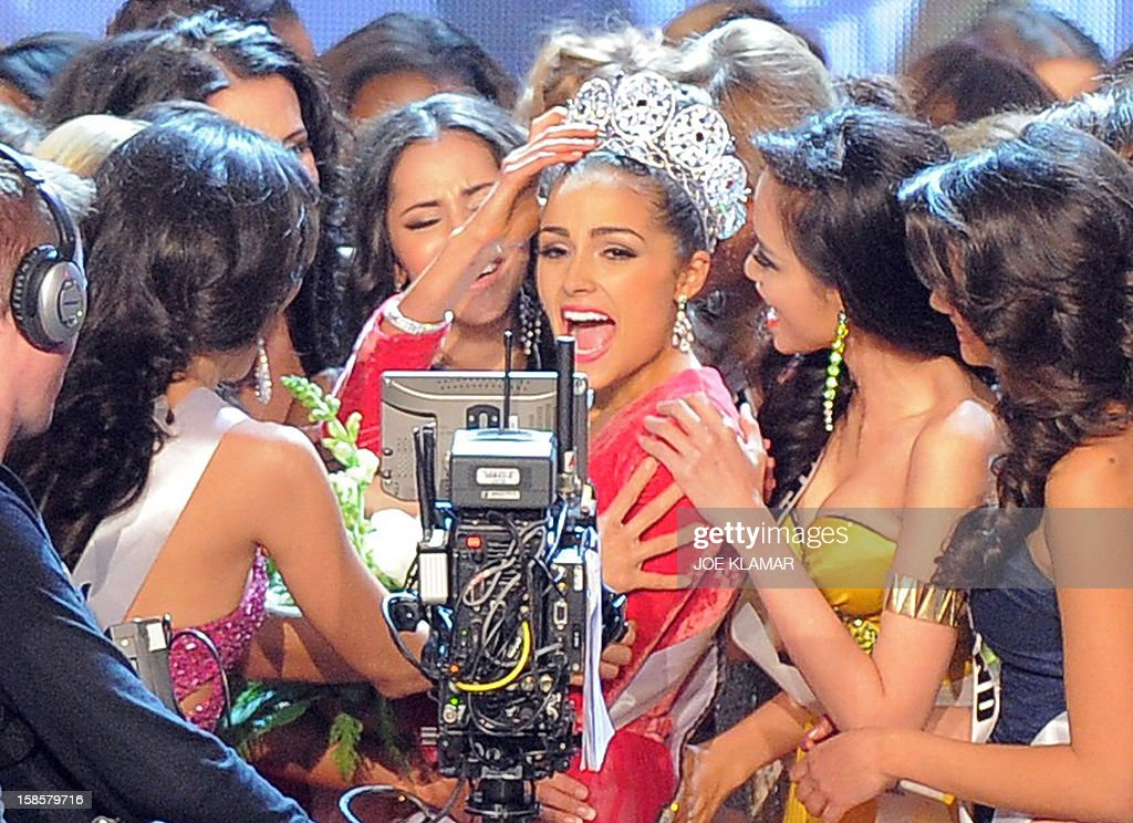 Miss USA, Olivia Culpo (C) is surrounded by contestants after being crowned Miss Universe 2012 during the Miss Universe Pageant at Planet Hollywood in Las Vegas, Nevada on December 19, 2012. Eighty-nine countries and territories took part in this year's pageant.