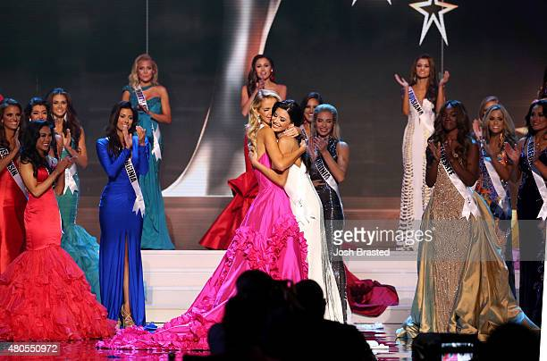 Miss USA Olivia Jordan of Oklahoma and Miss Texas Ylianna Guerra hug onstage at the 2015 Miss USA Pageant Only On ReelzChannel at The Baton Rouge...