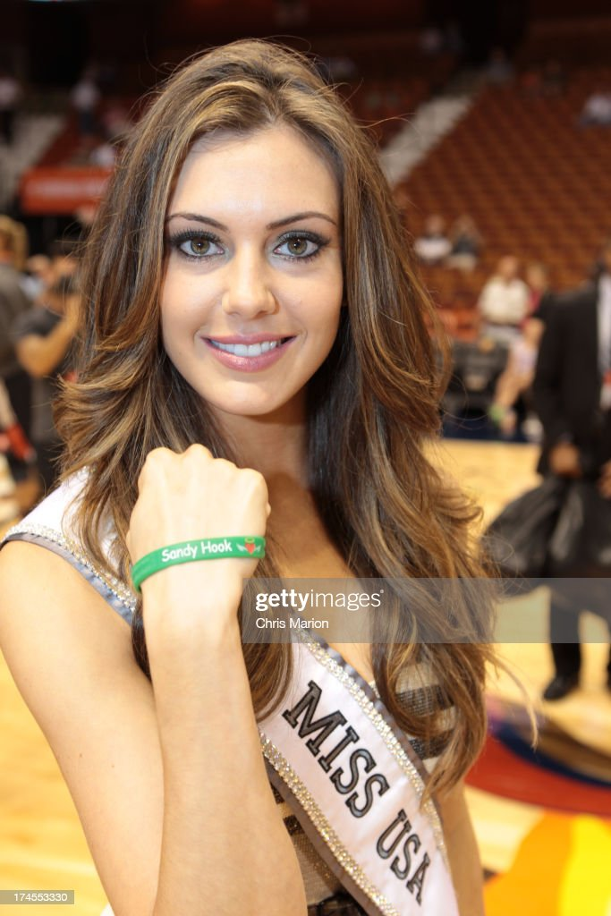 MIss USA winner Erin Brady poses with a Sandy Hook Elementary school wrist band during the 2013 Boost Mobile WNBA All-Star Game on July 27, 2013 at Mohegan Sun Arena in Uncasville, Connecticut.