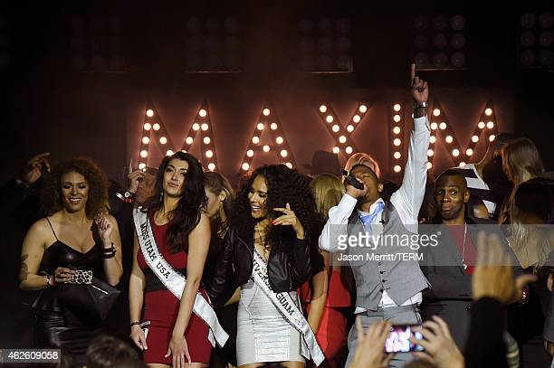 Miss Utah Nicol Powell Miss Guam Brittany Bell and actor/singer Nick Cannon perform onstage during the Maxim Party with Johnnie Walker Timex Dodge...