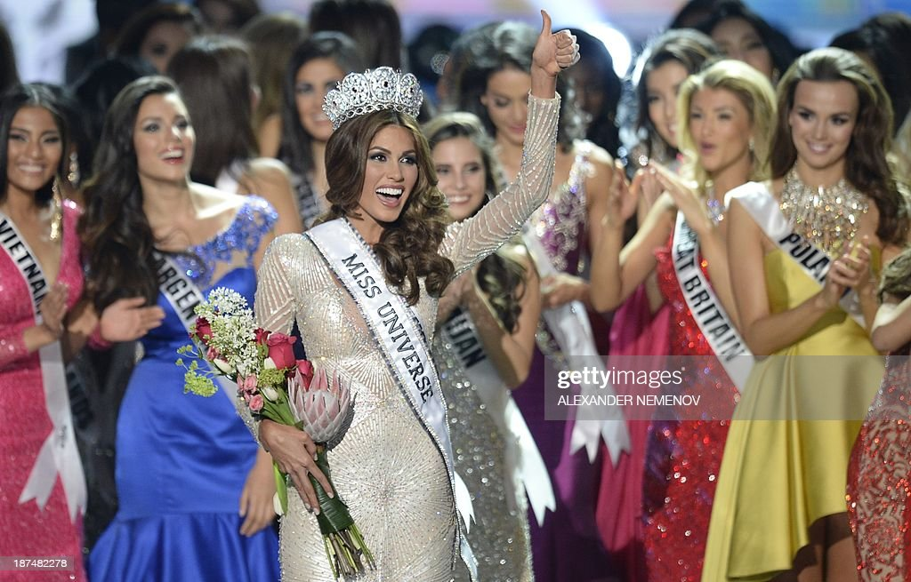 Miss Venezuela Gabriela Isler (C) celebrates with her crown during the 2013 Miss Universe competition in Moscow on November 9, 2013. A 25-year-old Venezuelan television presenter, Gabriela Isler, was crowned Miss Universe in Moscow in a glittering ceremony. Judges including rock star Steven Tyler from Aerosmith picked the winner from a total of 86 contestants at the show, watched by several billion viewers around the world.